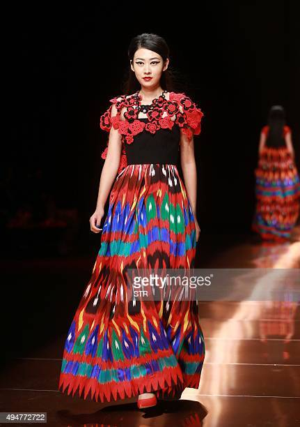 A model parades a creation from the Silk Road Star Cheng Yingfen collection designed by Cheng Yingfen at China Fashion Week in Beijing on October 29...