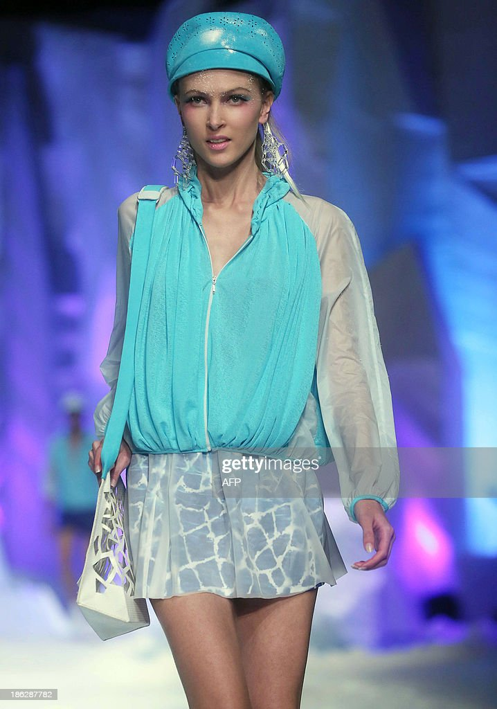 A model parades a creation from Toray Liu Wei Collection during China Fashion Week in Beijing on October 30 2013 China Fashion Week runs from October...