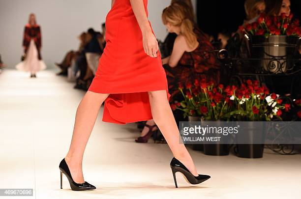 A model parades a garment by Australian designer Jayson Brunsdon during a parade at Fashion Week Australia in Sydney on April 14 2015 AFP PHOTO /...