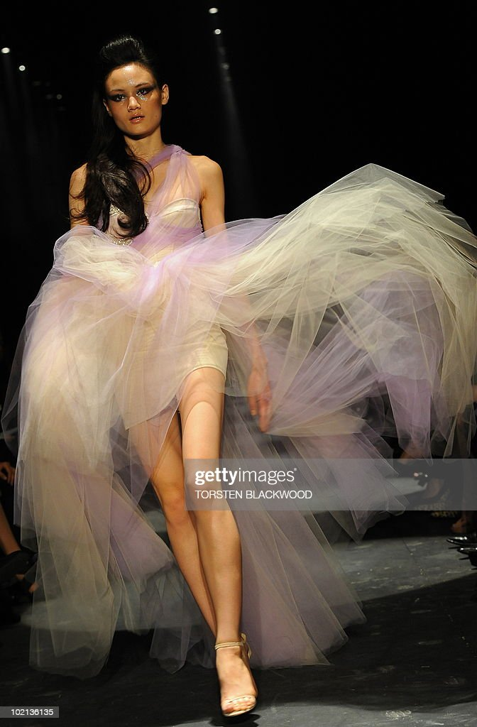 A model parades an evening gown during Alex Perry's 'Arabian Princess' show at Australian Fashion Week in Sydney on May 4, 2010. The event highlights Australia's leading apparel designers as well as the up and coming talent. AFP PHOTO / Torsten BLACKWOOD