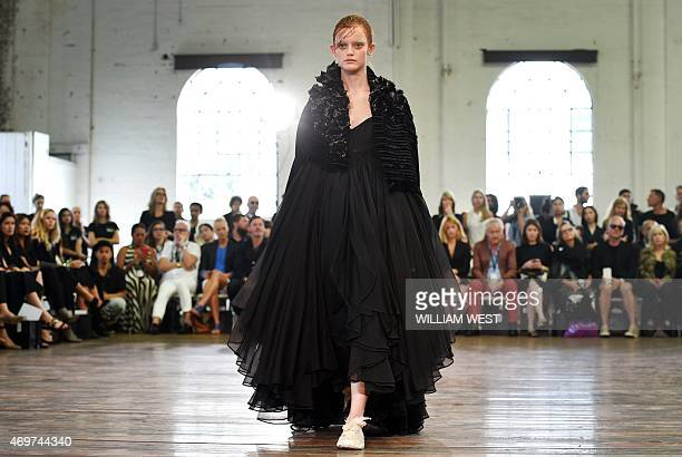 A model parades an outfit by Australian designer Akira Isogawa during Fashion Week Australia in Sydney on April 15 2015 AFP PHOTO / William WEST