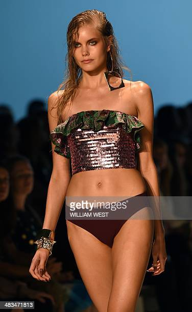 A model parades an outfit by Australian designer Jayson Brunsdon during a showing of his collection at Fashion Week Australia in Sydney on April 9...