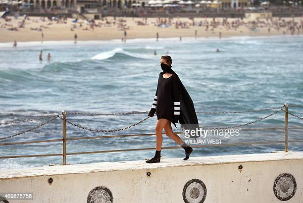 A model parades an outfit by fashion label Tenpieces at Bondi Beach during Fashion Week Australia in Sydney on April 16 2015 AFP PHOTO / William WEST