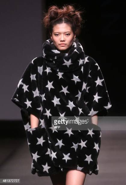 A model parades creations of 'Korean Fashion Designer Joint Collection' by South Korean designers during the biannual China Fashion Week in Beijing...