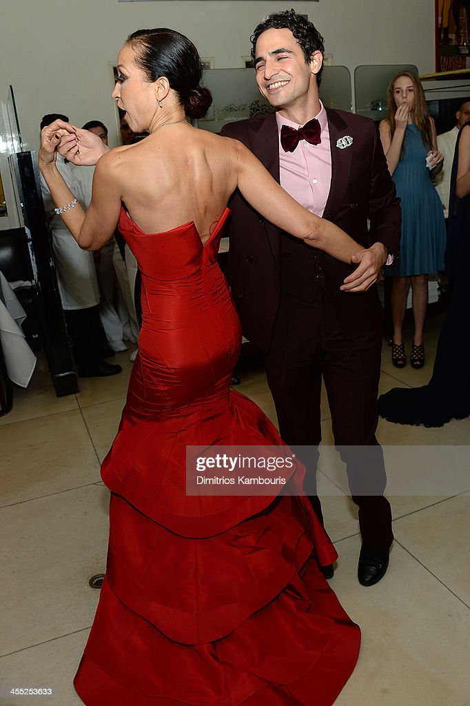 Model <a gi-track='captionPersonalityLinkClicked' href=/galleries/search?phrase=Pat+Cleveland+-+Model&family=editorial&specificpeople=592076 ng-click='$event.stopPropagation()'>Pat Cleveland</a> and designer Zac Posen dance at MAC Cosmetic's John Demsey and Zac Posen's dinner to celebrate his Pre- Fall Collection at Mr Chow on December 11, 2013 in New York City.