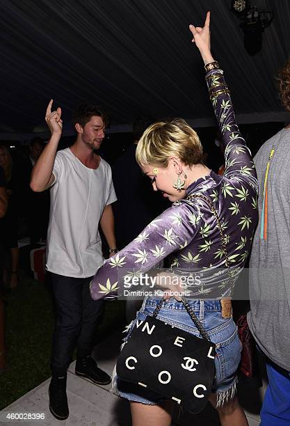 """Model Patrick Schwarzenegger and singer/songwriter Miley Cyrus attend Haute Living presents Hublot """"Time Is Beautiful"""" at the estate of JR and Loren..."""