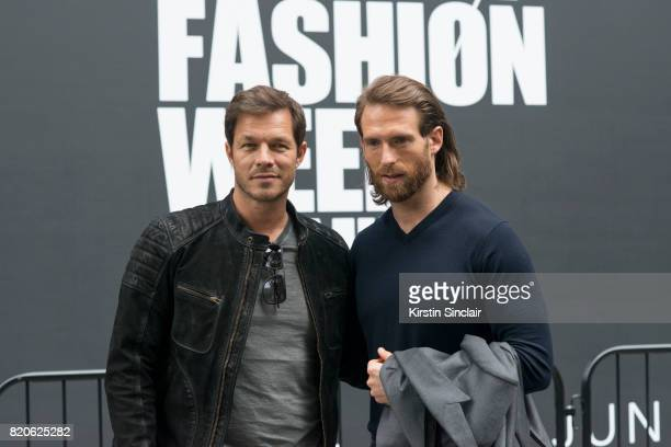 Model Paul Sculfor wears a Belstaff jacket and T shirt Dita Mach One sunglasses with Actor and Model Craig McGinlay on day 3 of London Collections...