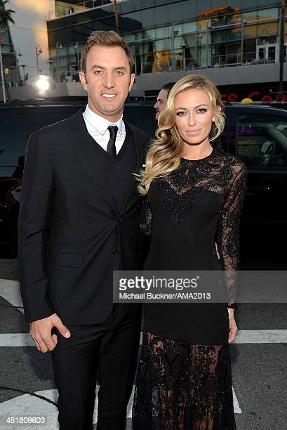 Model Paulina Gretsky and golfer Dustin Johnson attend the 2013 American Music Awards at Nokia Theatre LA Live on November 24 2013 in Los Angeles...