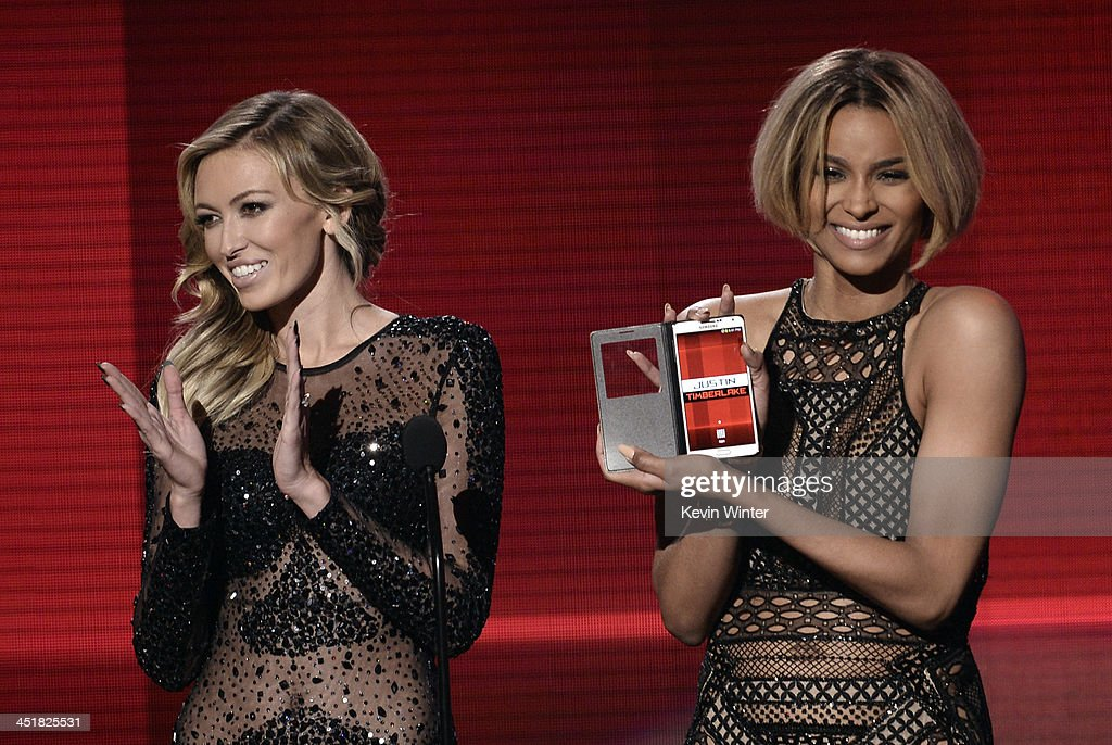 Model Paulina Gretzky and singer Ciara speak onstage during the 2013 American Music Awards at Nokia Theatre LA Live on November 24 2013 in Los...