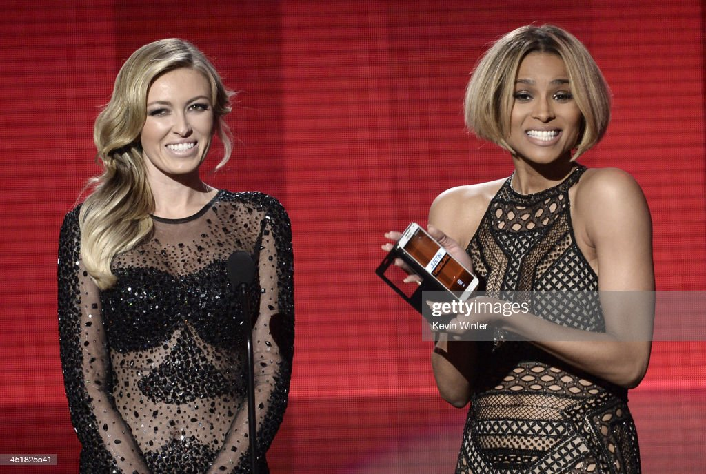Model Paulina Gretzky (L) and singer Ciara speak onstage during the 2013 American Music Awards at Nokia Theatre L.A. Live on November 24, 2013 in Los Angeles, California.