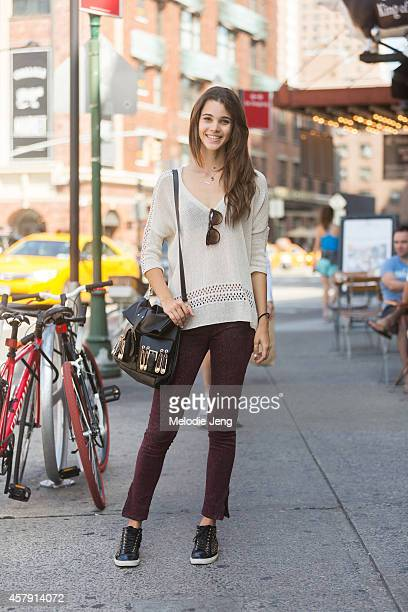 Model Pauline Hoarau carries a Versace bag in the Meatpacking District on Day 4 of New York Fashion Week Spring/Summer 2015 on September 7 2014 in...