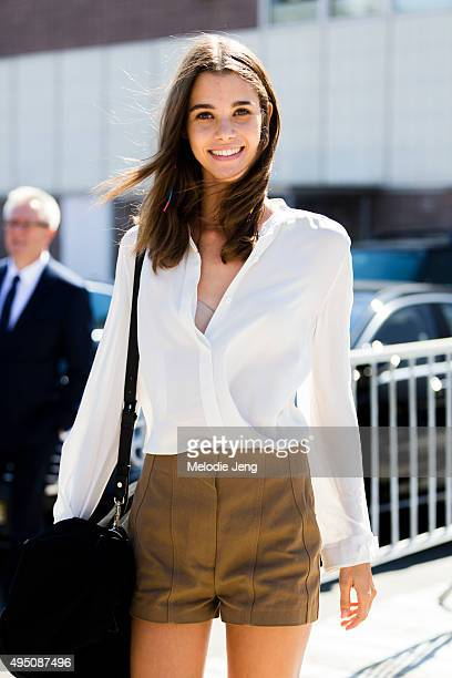 Model Pauline Hoarau exits the Tommy Hilfiger show at Pier 36 on September 14 2015 in New York City Pauline wears a crisp white buttonup top with...