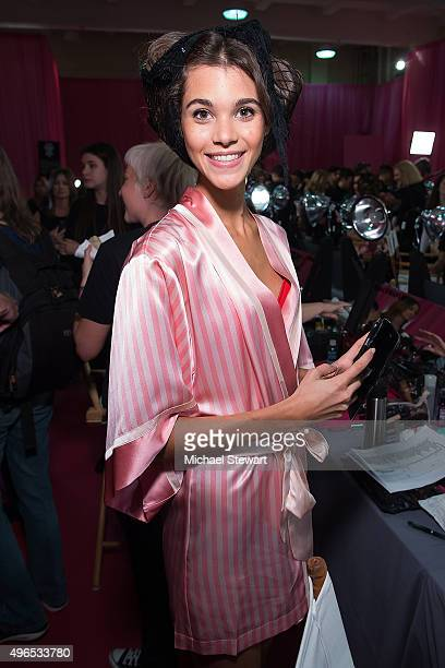 Model Pauline Hoarau prepares backstage before the 2015 Victoria's Secret Fashion Show at Lexington Armory on November 10 2015 in New York City