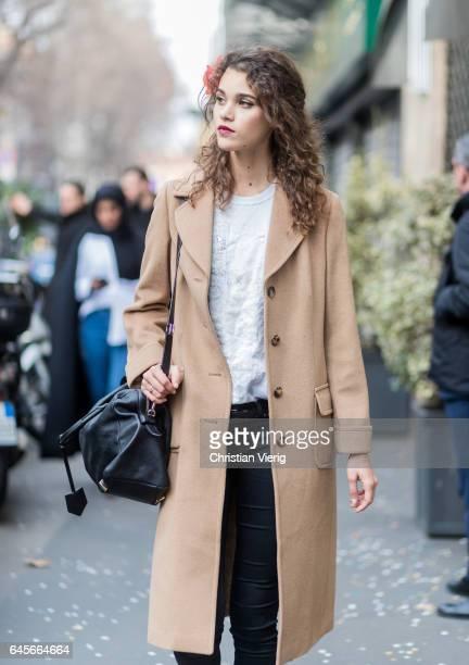 Model Pauline Hoarau wearing a beige coat outside Dolce Gabbana during Milan Fashion Week Fall/Winter 2017/18 on February 26 2017 in Milan Italy