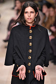 A model pays a tribute to singer David Bowie at the Burberry show during The London Collections Men AW16 at Kensington Gardens on January 11 2016 in...