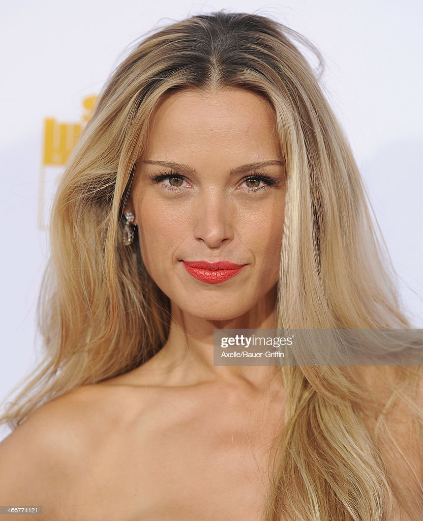 Model <a gi-track='captionPersonalityLinkClicked' href=/galleries/search?phrase=Petra+Nemcova&family=editorial&specificpeople=201716 ng-click='$event.stopPropagation()'>Petra Nemcova</a> arrives at NBC And Time Inc. Celebrate 50th Anniversary Of Sports Illustrated Swimsuit Issue at Dolby Theatre on January 14, 2014 in Hollywood, California.