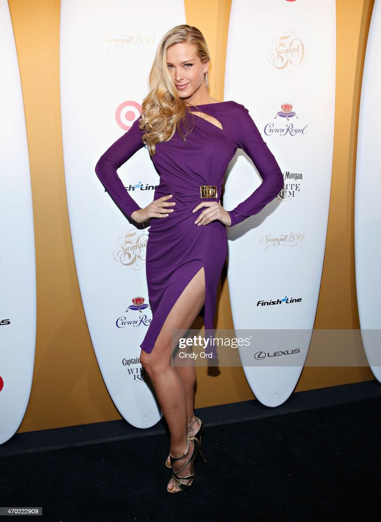 Model <a gi-track='captionPersonalityLinkClicked' href=/galleries/search?phrase=Petra+Nemcova&family=editorial&specificpeople=201716 ng-click='$event.stopPropagation()'>Petra Nemcova</a> attends as Captain Morgan White Rum and Crown Royal XO raise a glass to the Sports Illustrated Swimsuit 50 Years of Swim Issue at the Sports Illustrated Swimsuit Beach House on February 18, 2014 in New York City.