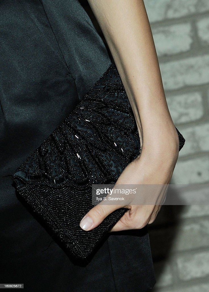 Model Petra Nemcova (clutch detail) attends the La Perla fall 2013 presentation during Mercedes-Benz Fashion Week at The Gallery at The Dream Downtown Hotel on February 7, 2013 in New York City.