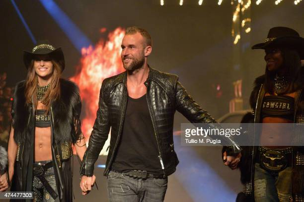 Model Philipp Plein and Naomi Campbell walk the runway during the Philipp Plein show as part of Milan Fashion Week Womenswear Autumn/Winter 2014 on...