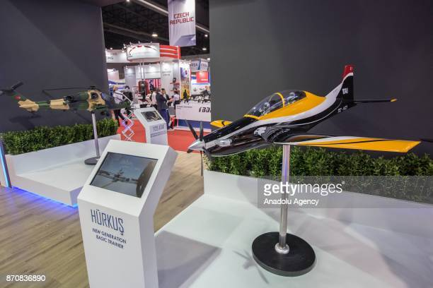 A model plane of 'Hurkus' translating 'Free Bird' is displayed at the stand of the Turkish company TAI during the first day of the Defense Security...