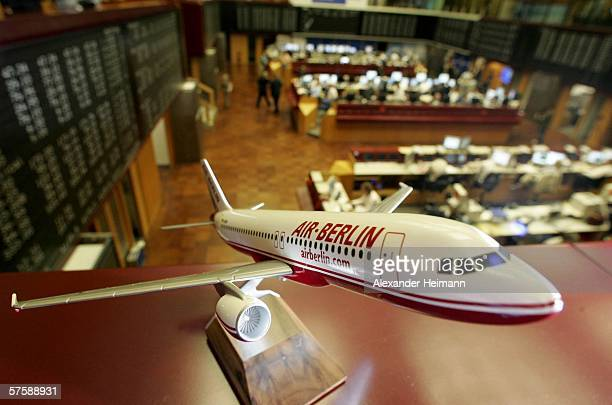 A model plane of the German airline company 'Air Berlin' is seen during the company's Initial Public Offering at the Frankfurt stock exchange on May...