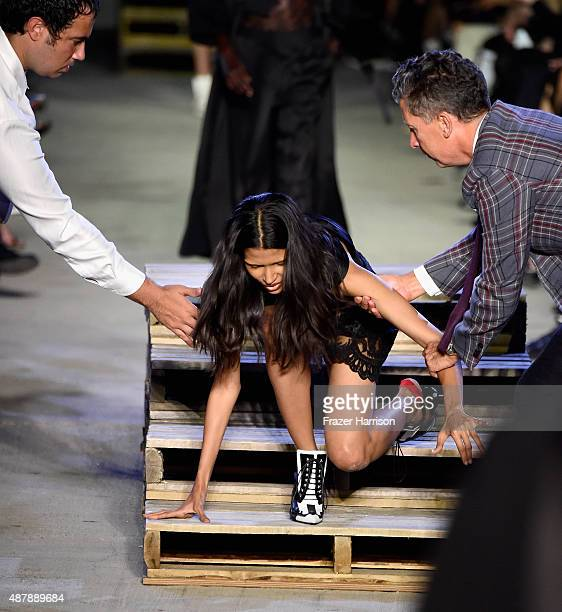 Model Pooja Mor wearing Givenchy Spring 2016 stumbles and falls on the runway during New York Fashion Week at Pier 26 at Hudson River Park on...