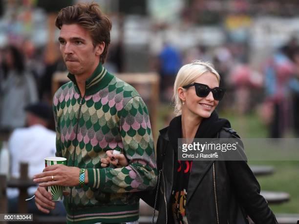 Model Poppy Delevingne and husband James Cook attend Glastonbury Festival on June 23 2017 in Glastonbury England