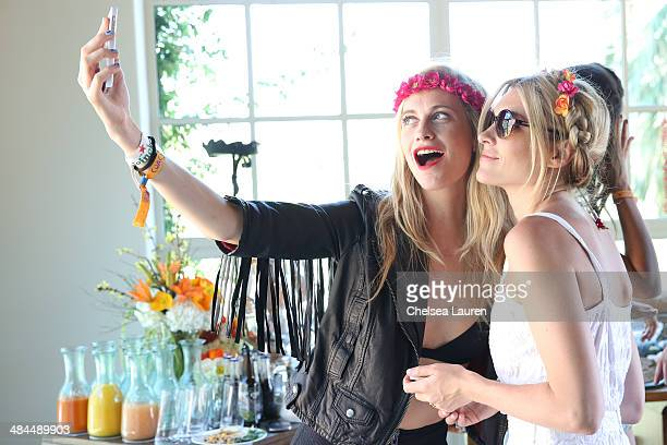 Model Poppy Delevingne and Jackie Swerz attend the Superdry Coachella brunch hosted by Poppy Delevingne on April 12 2014 in Palm Springs California