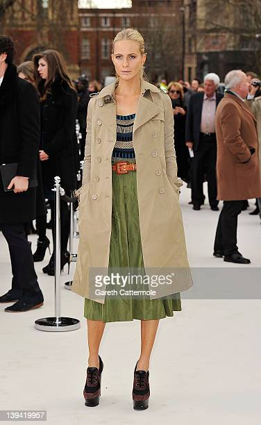 Model Poppy Delevingne arrives at the Burberry Autumn Winter 2012 Womenswear Show during London Fashion Week at Kensington Gardens on February 20...