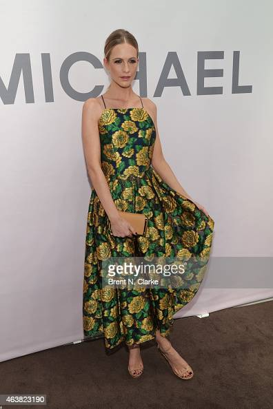 Model Poppy Delevingne arrives at the Michael Kors Miranda Eyewear Collection launch party at Michael Kors on February 18 2015 in New York City