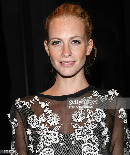 Model Poppy Delevingne attends FIJI Water at the 9th Annual Pink Party Benefiting The CedarsSinai Women's Cancer Program at HANGAR8 on October 19...
