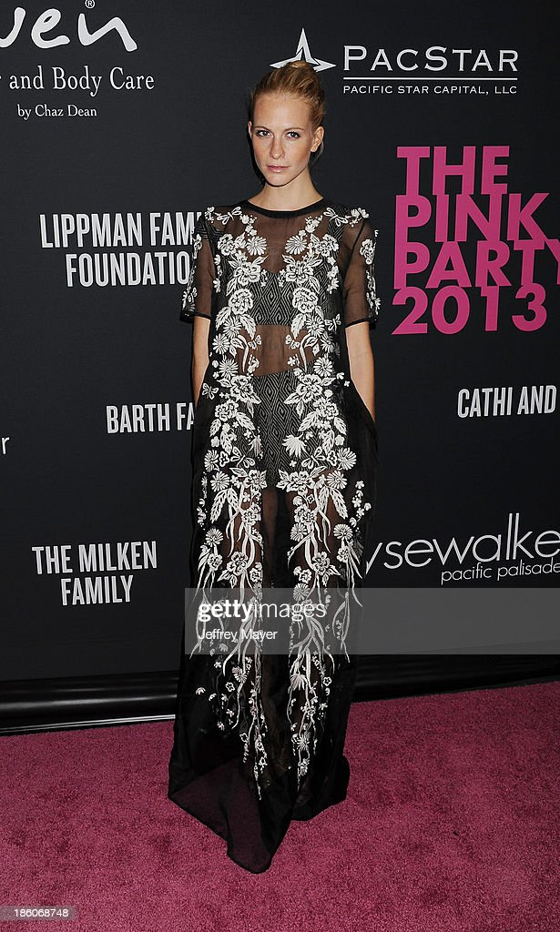 Model <a gi-track='captionPersonalityLinkClicked' href=/galleries/search?phrase=Poppy+Delevingne&family=editorial&specificpeople=2348985 ng-click='$event.stopPropagation()'>Poppy Delevingne</a> attends The Pink Party 2013 at Barker Hangar on October 19, 2013 in Santa Monica, California.