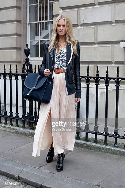 KINGDOM FEBRUARY 21 Model Poppy Delevingne wearing a bag by Tommy Ton for Club Monaco street style at London fashion week autumn/winter 2012...