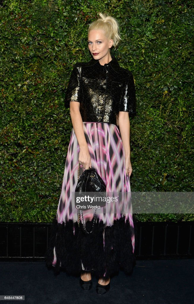 Model Poppy Delevingne, wearing CHANEL, attends the Charles Finch and CHANEL Pre-Oscar Awards Dinner at Madeo Restaurant on February 25, 2017 in Beverly Hills, California.