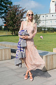Model Poppy Delevingne wears a Jill Sander dress and Malone Souliers shoes on day 3 during London Fashion Week Spring/Summer 2016/17 on September 20...