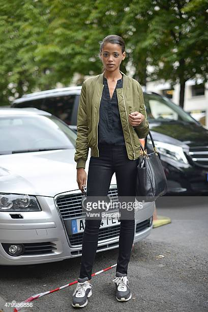 A model poses after the Fendi show at the Theatre des Champs Elysees on July 8 2015 in Paris France
