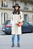 A model poses after the Hermes show wearing Burberry trench and Jerome Dreyfuss bag on Day 7 of Paris Fashion Week Womenswear FW15 on March 9 2015 in...