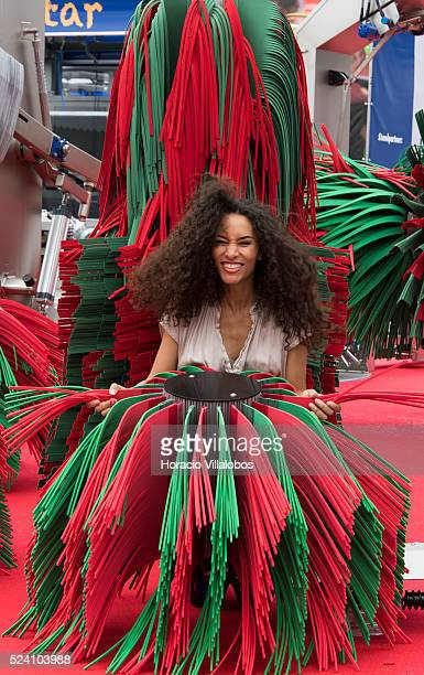 A model poses among brushes of a car wash system in Automechanika 2014 Frankfurt Germany 15 September 2014 a day before it opens to the public...