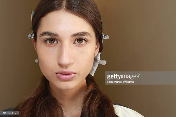 A model poses as she prepares backstage ahead of the Yeojin Bae show at MercedesBenz Fashion Week Resort 17 Collections at Carriageworks on May 16...