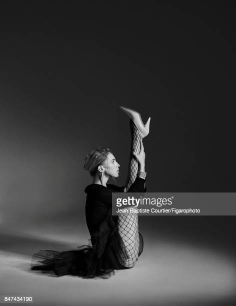 Model poses at a fashion shoot for Madame Figaro on July 12 2017 in Paris France Skirt sweater tights earring and cuff shoes PUBLISHED IMAGE CREDIT...