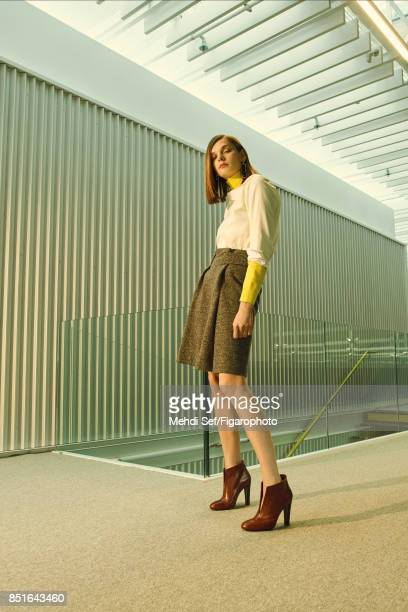 Model poses at a fashion shoot for Madame Figaro on July 22 2017 in Paris France Shirt sweater skirt earrings boots PUBLISHED IMAGE CREDIT MUST READ...