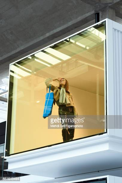 Model poses at a fashion shoot for Madame Figaro on July 22 2017 in Paris France Coat and tote shirt and pants PUBLISHED IMAGE CREDIT MUST READ Mehdi...
