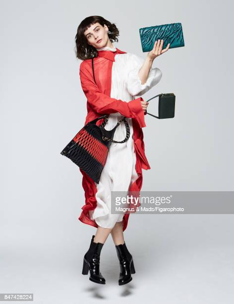 Model poses at a fashion shoot for Madame Figaro on July 8 2017 in Paris France Dresses clutch Paris bag Baltard bag boots PUBLISHED IMAGE CREDIT...