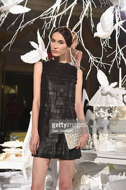 A model poses at Alice Olivia By Stacey Bendet presentation during MercedesBenz Fashion Week Spring 2015 at The Pierre Hotel on September 8 2014 in...