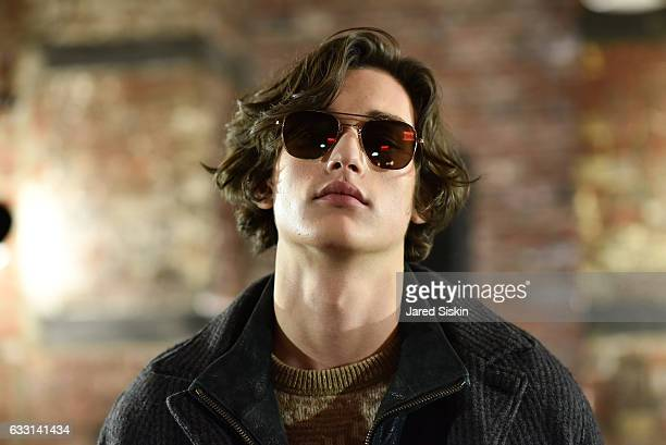 Model poses at Billy Reid Backstage NYFW Men's at The Cellar at The Beekman on January 30 2017 in New York City