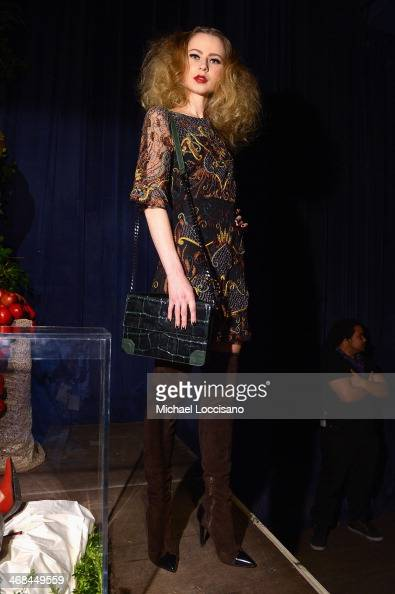 A model poses at the alice olivia by Stacey Bendet Fall 2014 presentation during MercedesBenz Fashion Week Fall 2014 at The McKittrick Hotel on...
