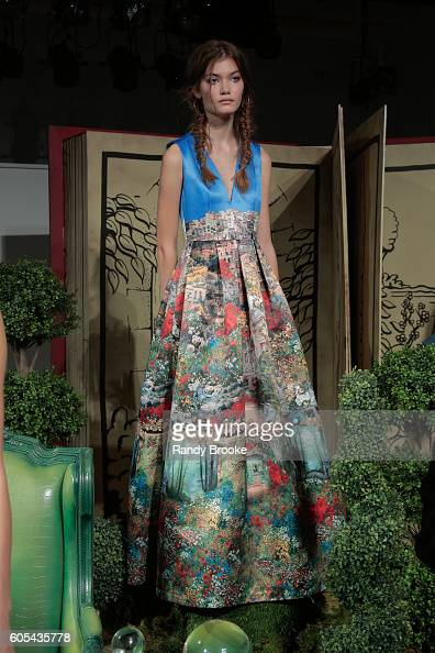 A model poses at the Alice Olivia by Stacey Bendet presentation during New York Fashion Week The Shows Spring 2017 at The Gallery Skylight at...