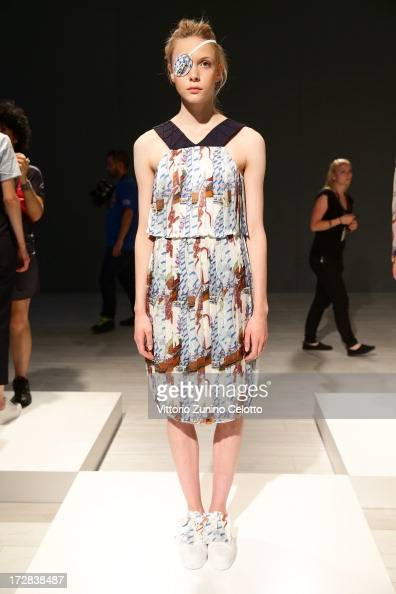 A model poses at the Asli Filinta Show during MercedesBenz Fashion Week Spring/Summer 2014 at Brandenburg Gate on July 5 2013 in Berlin Germany