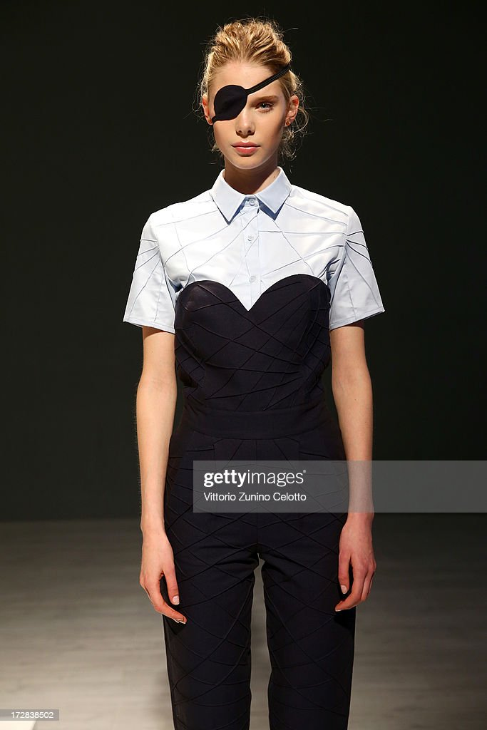 A model poses at the Asli Filinta Show during Mercedes-Benz Fashion Week Spring/Summer 2014 at Brandenburg Gate on July 5, 2013 in Berlin, Germany.