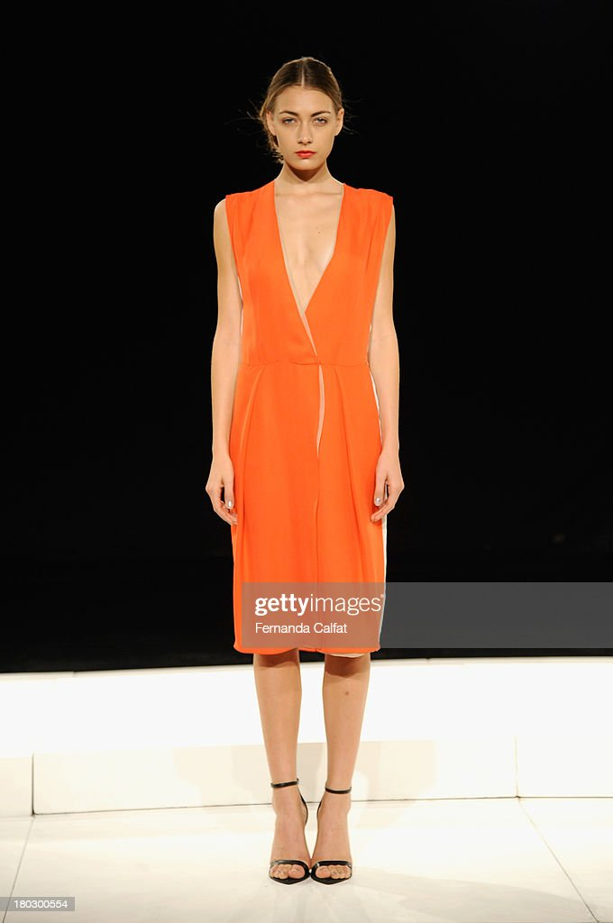 A model poses at the Brandon Sun fashion presentation during Mercedes-Benz Fashion Week Spring 2014 at The Box at Lincoln Center on September 11, 2013 in New York City.